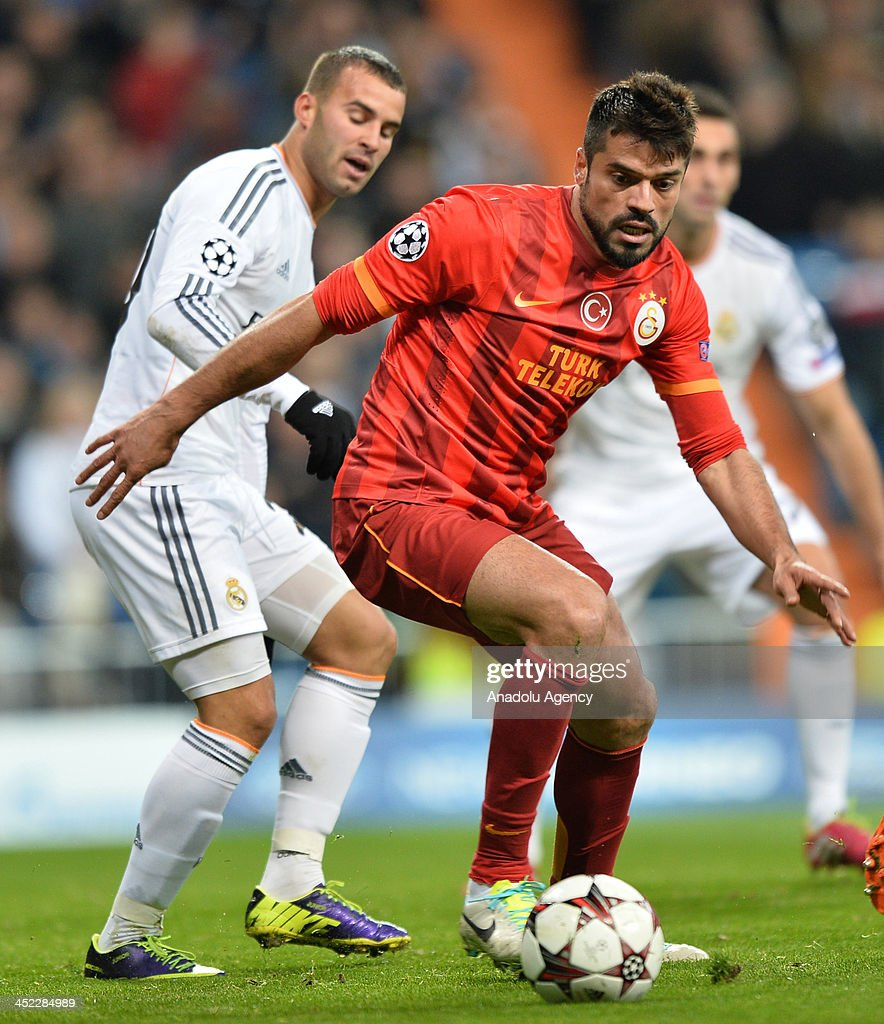 Galatasaray's Gokhan Zan (R) vies for the ball during the UEFA Champions League football match between Real Madrid vs Galatasaray at the Santiago Bernabeu Stadium on November 27, 2013 in Madrid.