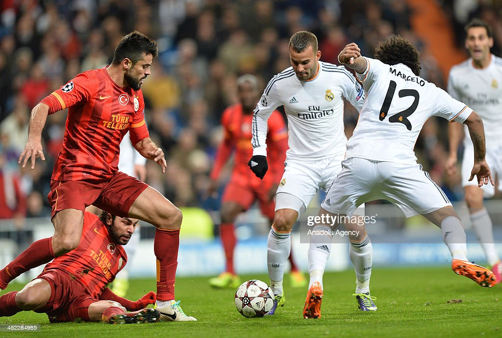 Galatasaray's Gokhan Zan (L) vies for the ball with Real Madrid's Marcelo (R) during the UEFA Champions League football match between Real Madrid vs Galatasaray at the Santiago Bernabeu Stadium on November 27, 2013 in Madrid.