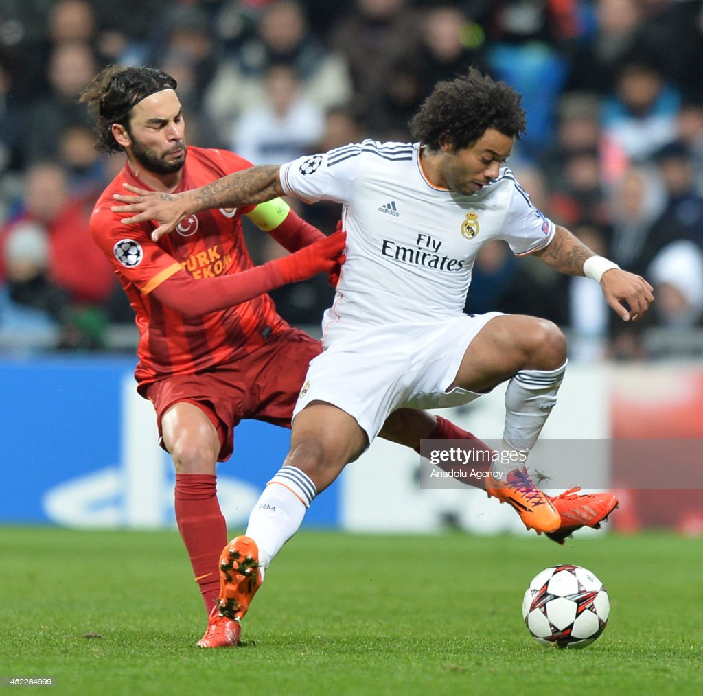Galatasaray's Gokhan Zan (L) vies with Real Madrid's Marcelo (R) during the UEFA Champions League football match between Real Madrid vs Galatasaray at the Santiago Bernabeu Stadium on November 27, 2013 in Madrid.