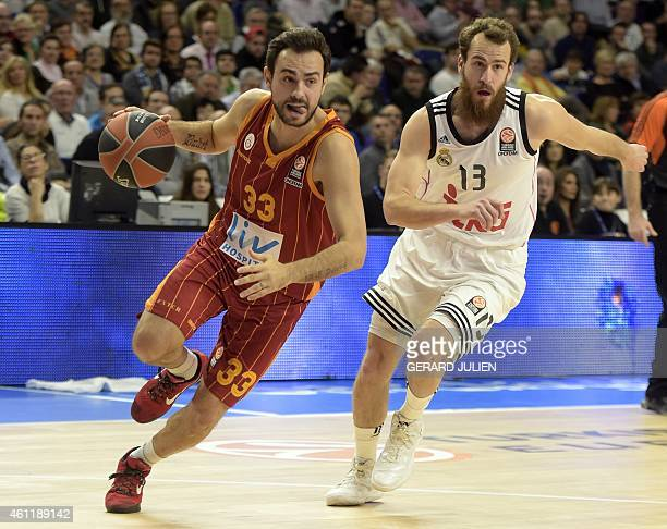 Galatasaray's guard Ender Arslan vies with Real Madrid's guard Sergio Rodriguez during the Euroleague group E basketball match Real Madrid vs...