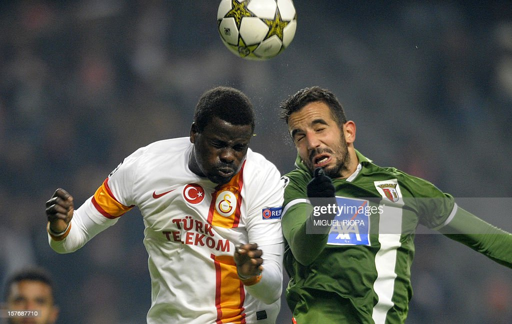 Galatasaray's Ivorian defender Emmanuel Eboue (L) vies with SC Braga's midfielder Ruben Amorim (R) during the UEFA Champions League Group H football match SC Braga vs Galatasaray at the AXA Stadium in Braga, northern Portugal, on December 5, 2012. Galatasaray won the match 2-1. AFP PHOTO / MIGUEL RIOPA