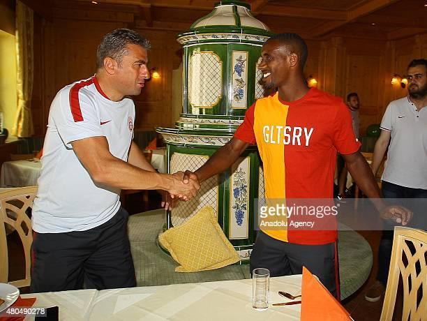 Galatasaray's Lionel Carole and head coach Hamza Hamzaoglu attend their team's training session on July 12 2015 in Windischgarsten Austria