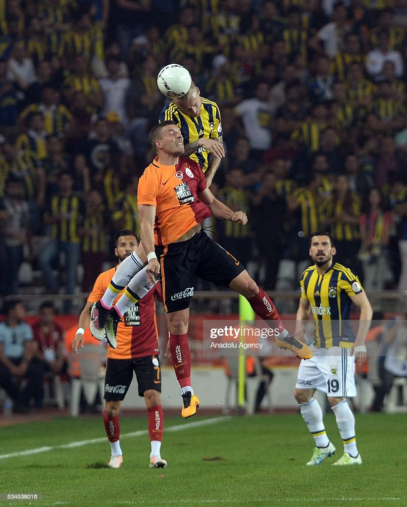 Galatasaray's Lukas Podolski (front) and Fenerbahce's Simon Kjaer (rear) vie for the ball during the Ziraat Turkish Cup Final match between Galatasaray and Fenerbahce at Antalya Ataturk Stadium in Antalya, Turkey on May 26, 2016.