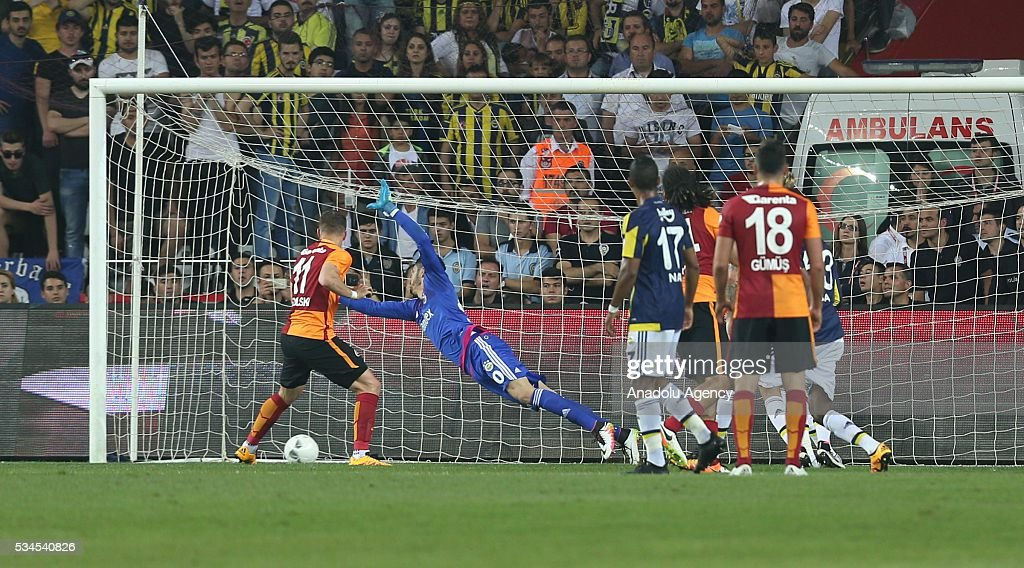 Galatasaray's Lukas Podolski (left) scores a goal during the Ziraat Turkish Cup Final match between Galatasaray and Fenerbahce at Antalya Ataturk Stadium in Antalya, Turkey on May 26, 2016.