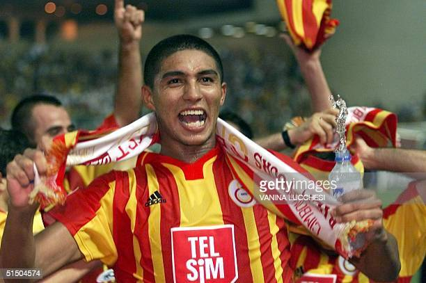 Galatasaray's Mario Jardel who scored twice for his team celebates after his team won 21 the SuperCup final against Real Madrid in Monaco 25 August...