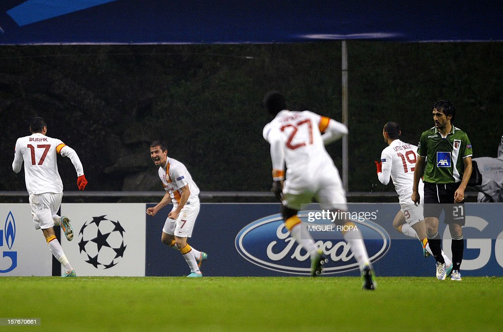 Galatasaray's midfielder Aydin Yilmaz (2nd L) celebrates after scoring during the UEFA Champions League Group H football match SC Braga vs Galatasaray at the AXA Stadium in Braga, northern Portugal, on December 5, 2012. AFP PHOTO / MIGUEL RIOPA