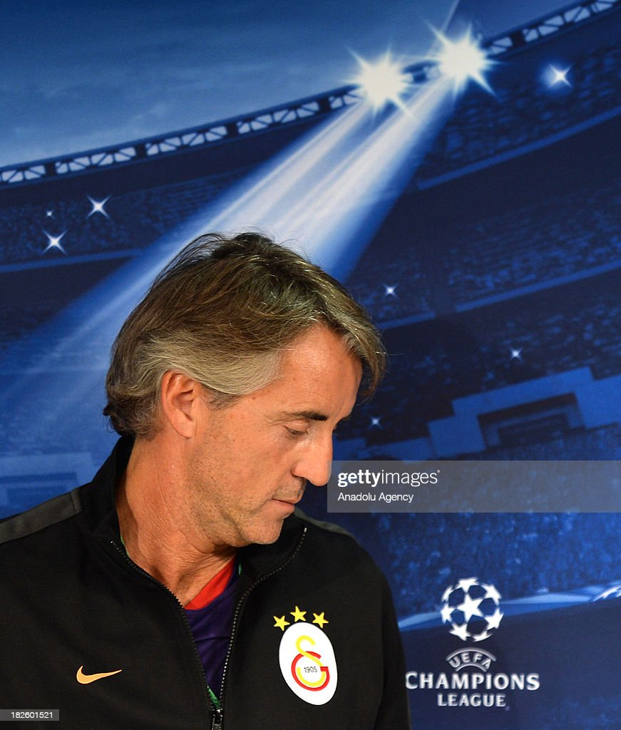 Galatasaray's new head coach Roberto Mancini arrives for a press conference ahead of Champions League group B soccer match between Juventus and Galatasaray at the Juventus stadium on October 01, 2013 in Turin, Italy.