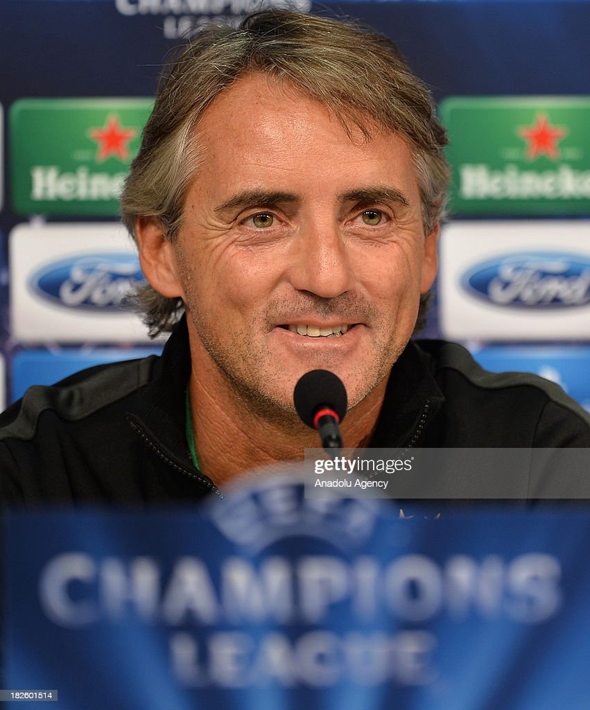 Galatasaray's new head coach Roberto Mancini smiles during a press conference ahead of Champions League group B soccer match between Juventus and Galatasaray at the Juventus stadium on October 01, 2013 in Turin, Italy.