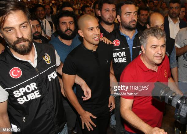Galatasaray's new transfer Algerian Sofiane Feghouli is welcomed by Galatasaray's officials as he arrives at the Istanbul Ataturk Airport in Istanbul...