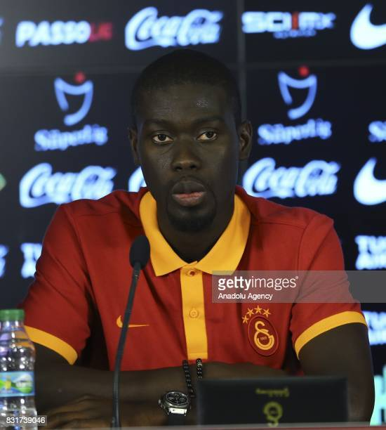 Galatasaray's new transfer Badou Ndiaye and Galatasaray's President Dursun Ozbek pose for a photo with Galatasaray jersey after a signing ceremony at...