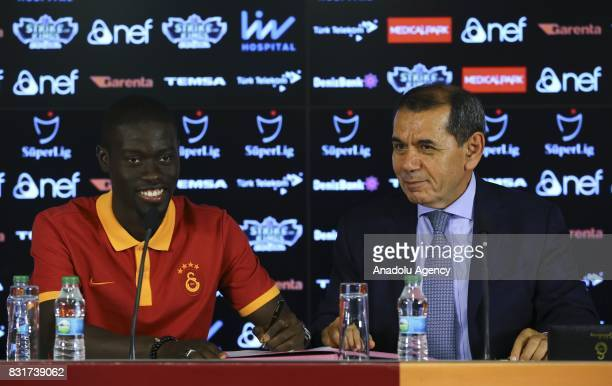 Galatasaray's new transfer Badou Ndiaye and Galatasaray's President Dursun Ozbek attend a signing ceremony at Turk Telekom Stadium in Istanbul Turkey...