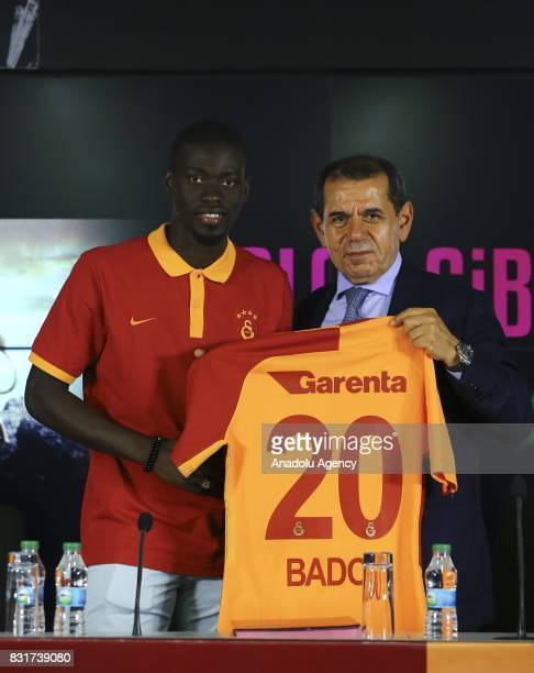 Galatasaray's new transfer Badou Ndiaye and Galatasaray's President Dursun Ozbek pose for a photo with Galatasary jersey after a signing ceremony at...