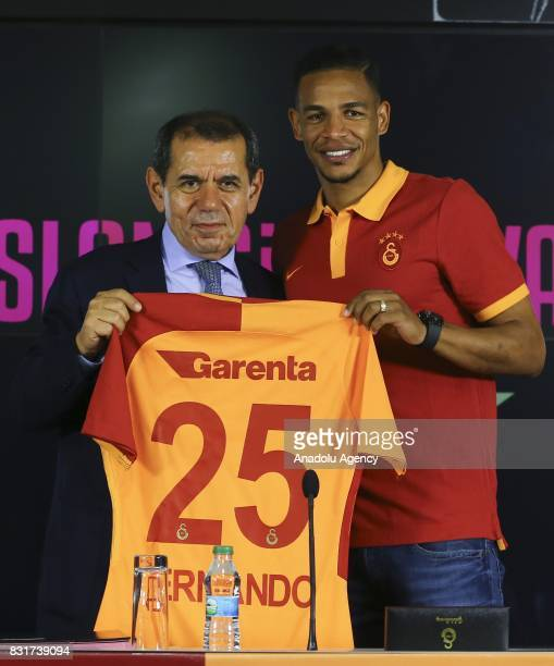 Galatasaray's new transfer Fernando and Galatasaray's President Dursun Ozbek pose for a photo with Galatasaray jersey after a signing ceremony at...