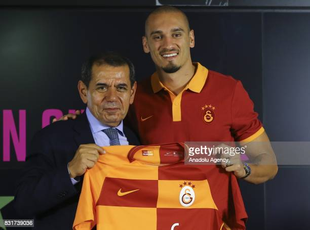 Galatasaray's new transfer Maicon and Galatasaray's President Dursun Ozbek pose for a photo with Galatasaray jersey after a signing ceremony at Turk...
