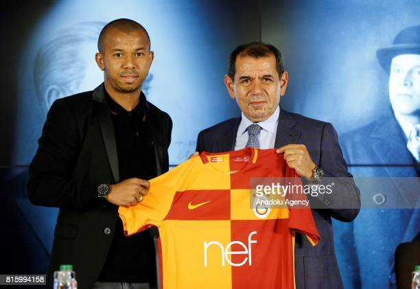 Galatasaray's new transfer Mariano Ferreira Filho and Galatasaray's President Dursun Ozbek pose for a photo during the signing ceremony at Turk...