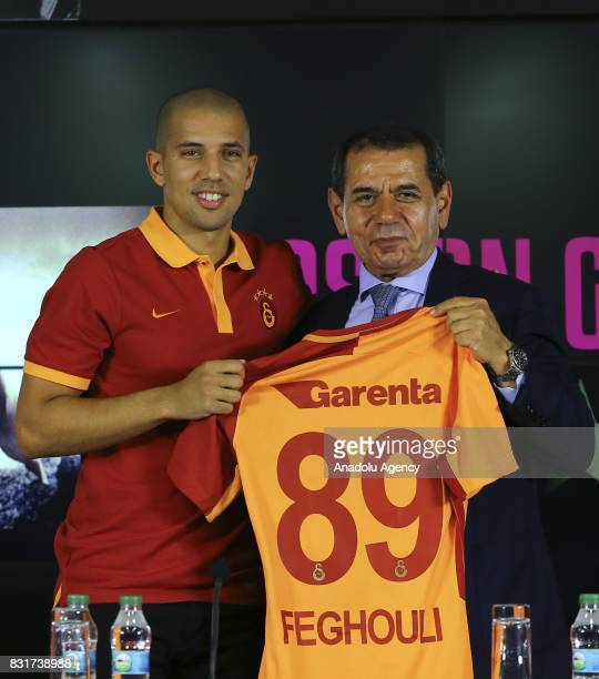 Galatasaray's new transfer Sofiane Feghouli and Galatasaray's President Dursun Ozbek pose for a photo with Galatasaray jersey after a signing...