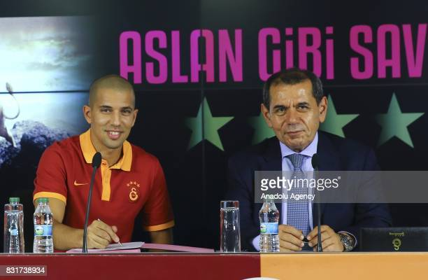 Galatasaray's new transfer Sofiane Feghouli attends a signing ceremony with Galatasaray's President Dursun Ozbek at Turk Telekom Stadium in Istanbul...