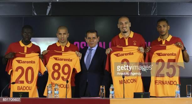 Galatasaray's new transfers Badou Ndiaye Sofiane Feghouli Maicon and Fernando pose with Galatasaray's President Dursun Ozbek during a signing...