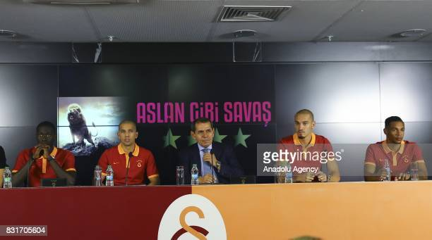 Galatasaray's new transfers Badou Ndiaye Sofiane Feghouli Maicon and Fernando attend a signing ceremony with Galatasaray's President Dursun Ozbek at...