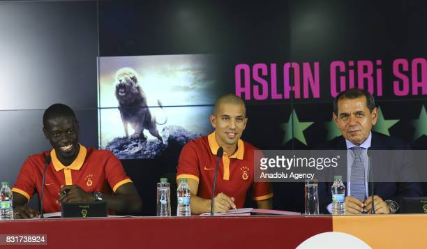 Galatasaray's new transfers Sofiane Feghouli and Badou Ndiaye attend a signing ceremony with Galatasaray's President Dursun Ozbek at Turk Telekom...