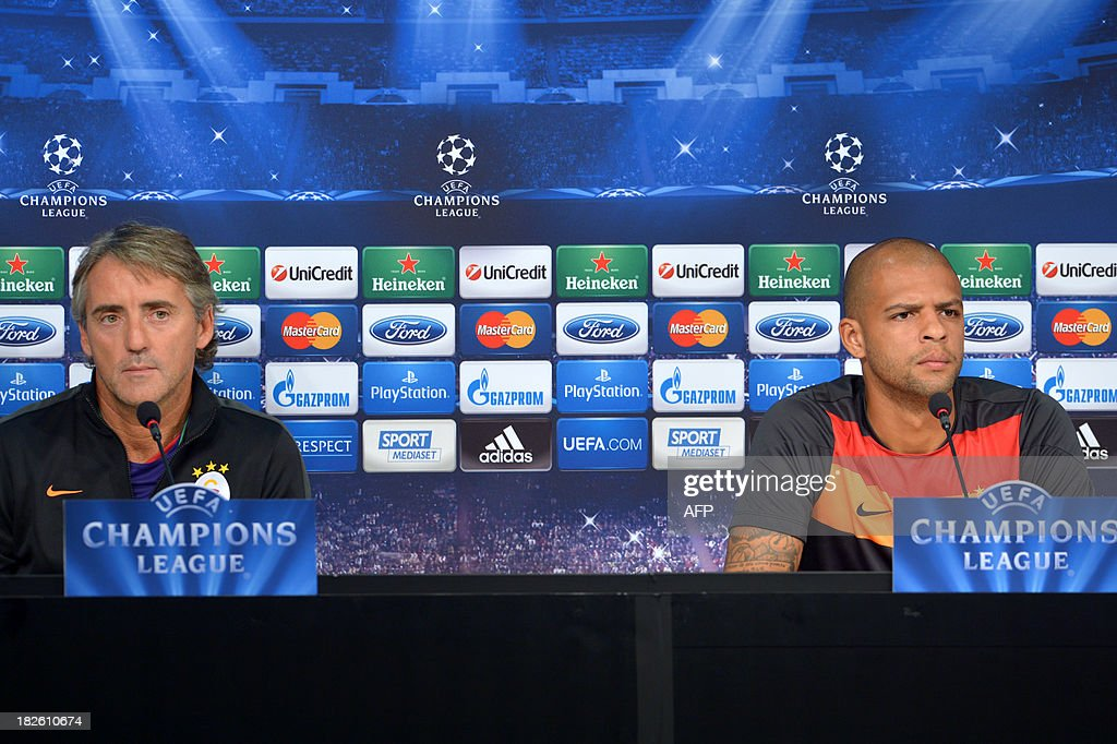 Galatasaray's newly appointed headcoach Roberto Mancini (L) and Felipe Melo attend a press conference on the eve of the Champion's League football match Juventus vs Galatasaray on October 1, 2013 in Turin. Mancini, sacked by Manchester City at the end of last season following a shock defeat to Wigan in the final of the FA Cup, signed a three-year contract to manage the struggling Turkish champions.