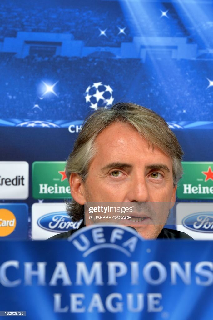 Galatasaray's newly appointed headcoach Roberto Mancini attends a press conference on the eve of the Champion's League football match Juventus vs Galatasaray on October 1, 2013 in Turin. Mancini, sacked by Manchester City at the end of last season following a shock defeat to Wigan in the final of the FA Cup, signed a three-year contract to manage the struggling Turkish champions. AFP PHOTO / GIUSEPPE CACACE