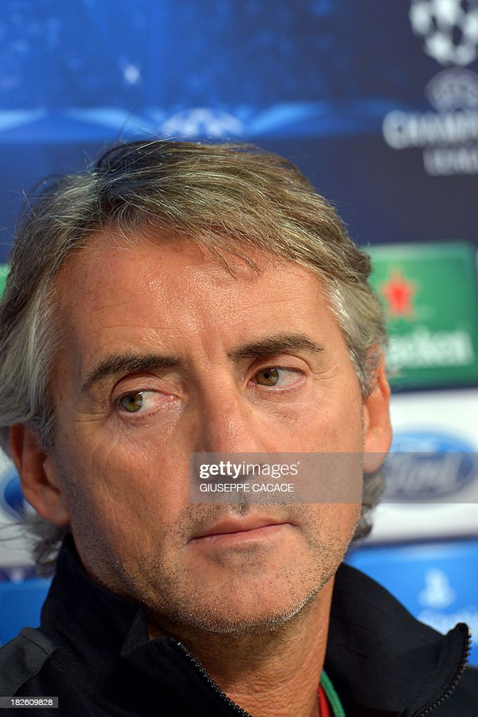 Galatasaray's newly appointed headcoach Roberto Mancini attends a press conference on the eve of the Champion's League football match Juventus vs Galatasaray on October 1, 2013 in Turin. Mancini, sacked by Manchester City at the end of last season following a shock defeat to Wigan in the final of the FA Cup, signed a three-year contract to manage the struggling Turkish champions.