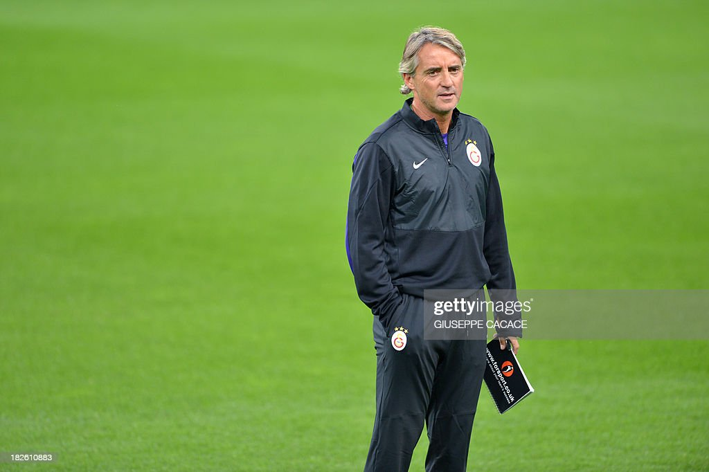 Galatasaray's newly appointed headcoach Roberto Mancini attends a training session on the eve of the Champion's League football match Juventus vs Galatasaray on October 1, 2013 in Turin. Mancini, sacked by Manchester City at the end of last season following a shock defeat to Wigan in the final of the FA Cup, signed a three-year contract to manage the struggling Turkish champions.