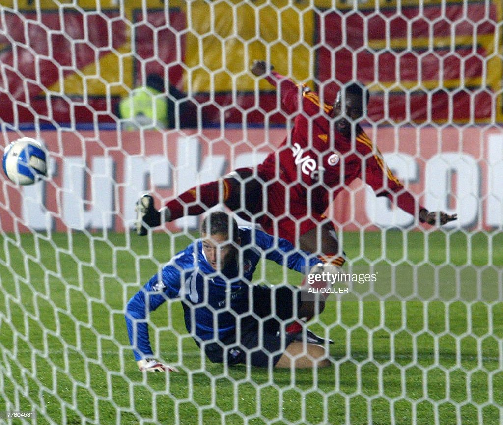 Galatasaray's Nonda Shabani Christophe (back) fights for the ball with Helsingborg's goalkeeper Anderson Daniel (front) during their UEFA Cup match at Ali Samiyen Stadium, 08 November 2007, in Istanbul.