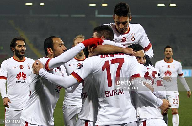 Galatasaray's players celebrate after scoring a goal during the Turkish Super League football between Genclerbirligi and Galatasaray at the May 19...
