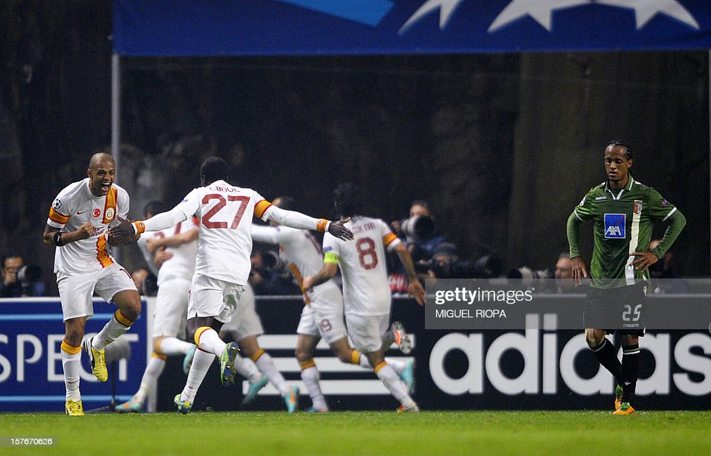 Galatasaray's players celebrate after scoring their second goal during the UEFA Champions League Group H football match SC Braga vs Galatasaray at the AXA Stadium in Braga, northern Portugal, on December 5, 2012.