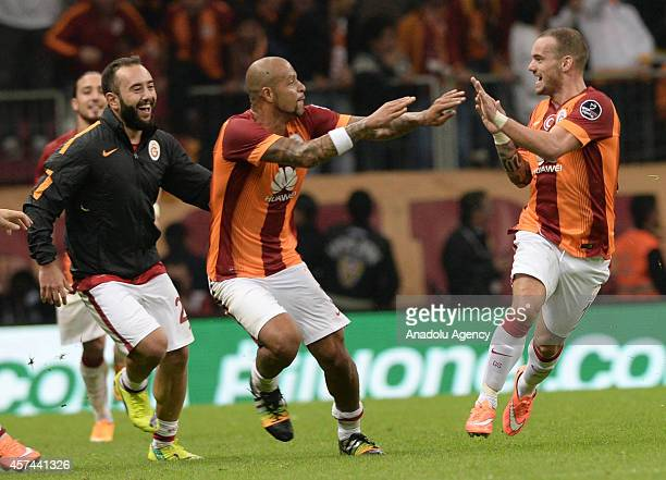 Galatasaray's players celebrate celebrate after Wesley Sneijder's goal during the Turkish Spor Toto Super League derby game between Galatasaray and...