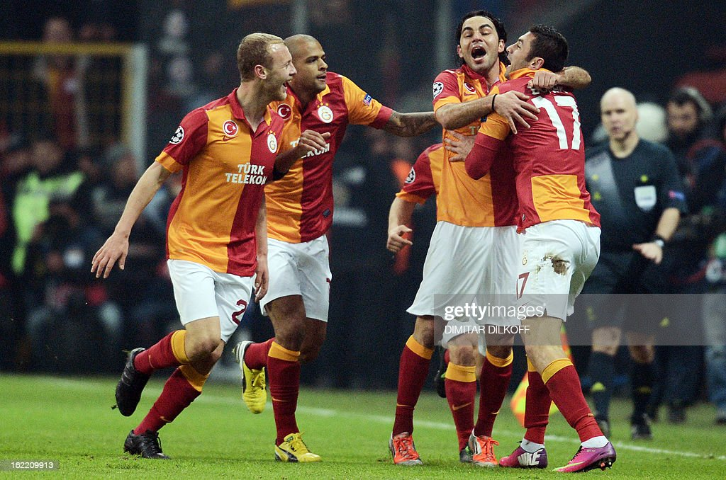 Galatasaray's players celebrate their first goal during an UEFA Champions League football match between Galatasaray and FC Schalke 04 at the Ali Samiyen stadium in Istanbul on February 20, 2013.