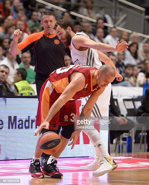 Galatasaray's Puerto Rican guard Carlos Arroyo vies with Real Madrid's guard Sergio Rodriguez during the Euroleague group basketball match Real...