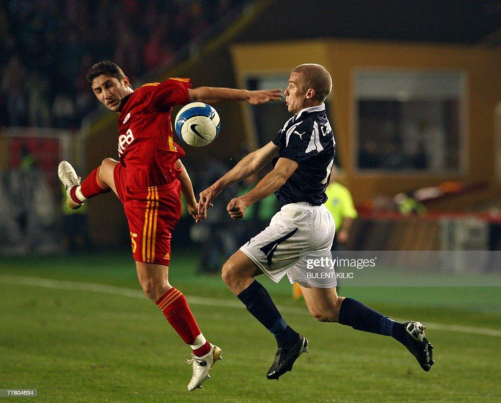 Galatasaray's Sabri Sarioglu (L) fights for the ball with Helsingborg's Ronningberg Oskar during their UEFA Cup football match at Ali Samiyen Stadium, 08 November 2007, in Istanbul.