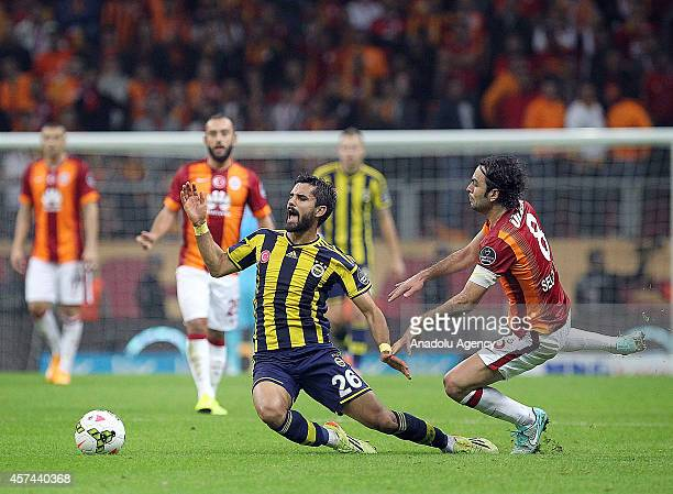 Galatasaray's Selcuk Inan and Fenerbahce's Alper Potuk vie for the ball during the Turkish Spor Toto Super League derby game between Galatasaray and...
