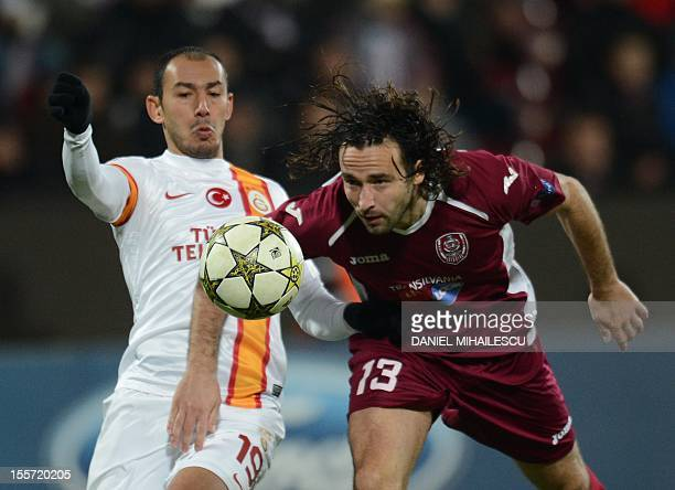 Galatasaray's striker Umut Bulut and Cluj's Italian defender Felice Piccolo vie for the ball during the UEFA Champions League Group H football match...