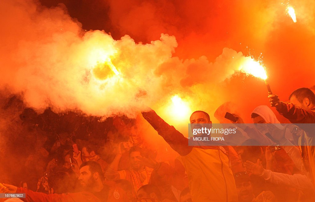 Galatasaray's supporters light flares during the UEFA Champions League Group H football match SC Braga vs Galatasaray at the AXA Stadium in Braga, northern Portugal, on December 5, 2012. Galatasaray won the match 2-1.