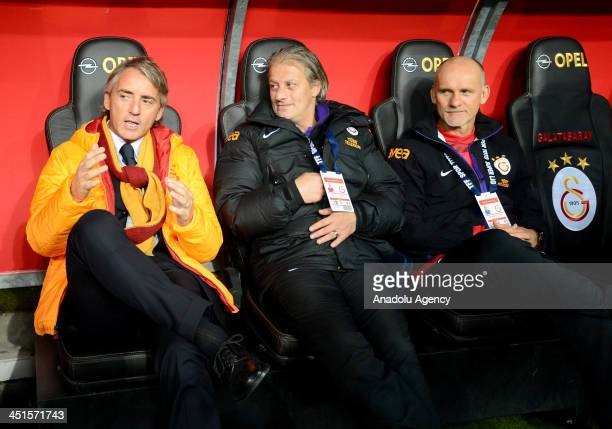 Galatasaray's technical director Roberto Mancini assistant director Tugay Kerimoglu and goalkeeper coach Claudio Taffarel are seen before the Turkish...