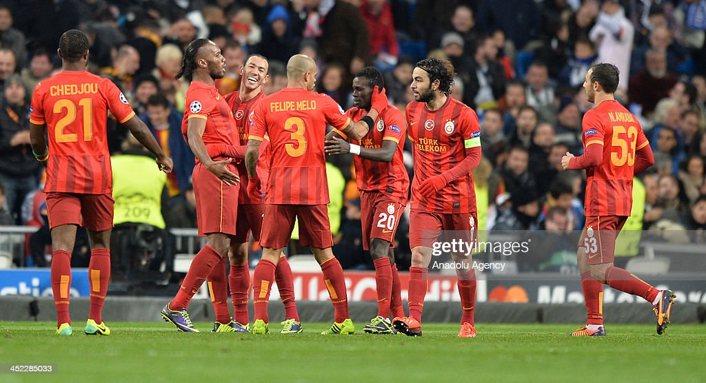 Galatasaray's Umut Bulut (3rd L) celebrates after scoring their team first goal with his teammates during the UEFA Champions League football match between Real Madrid vs Galatasaray at the Santiago Bernabeu Stadium on November 27, 2013 in Madrid.