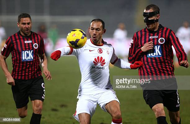 Galatasaray's Umut Bulut vies for the ball with Genclerbirligi's Radosav Petrovic and Dusko Tosic during the Turkish Super League football between...