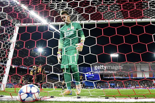 Galatasaray's Uruguayan goalkeeper Fernando Muslera looks at the ball after Atletico Madrid's French forward Antoine Griezmann scored during the UEFA...