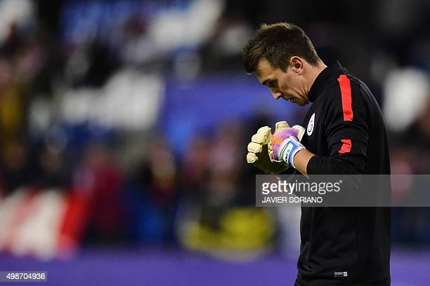Galatasaray's Uruguayan goalkeeper Fernando Muslera looks down as he warms up before the UEFA Champions League Group C football match Club Atletico...