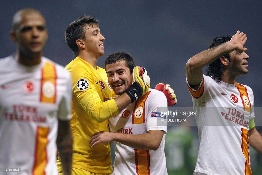Galatasaray's Uruguayan goalkeeper Fernando Muslera (2nd L), midfielder Aydin Yilmaz (C) and midfielder Selcuk Inan (R) celebrate their victory at the end of the UEFA Champions League Group H football match SC Braga vs Galatasaray at the AXA Stadium in Braga, northern Portugal, on December 5, 2012. Galatasaray won the match 2-1.