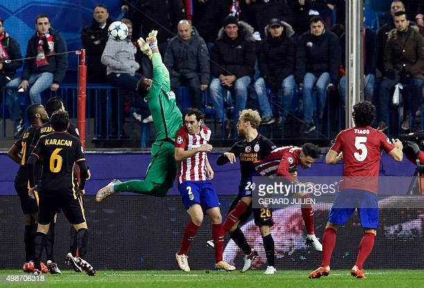 Galatasaray's Uruguayan goalkeeper Fernando Muslera tries to stop a ball next to Atletico Madrid's Uruguayan defender Diego Godin during the UEFA...