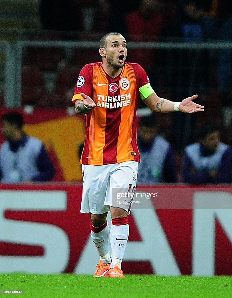 Galatasaray's <a gi-track='captionPersonalityLinkClicked' href=/galleries/search?phrase=Wesley+Sneijder&family=editorial&specificpeople=538145 ng-click='$event.stopPropagation()'>Wesley Sneijder</a> reacts during the UEFA Champions League group D football match Galatasaray vs Arsenal at TT Arena Stadium on December 9, 2014 in Istanbul. AFP PHOTO / OZAN KOSE
