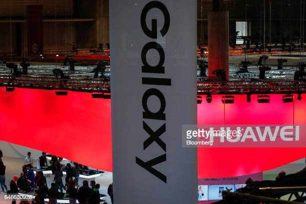 A Galaxy banner hangs above the Samsung Electronics Co stand near to the Huawei Technologies Co Ltd stand on the third day of Mobile World Congress...
