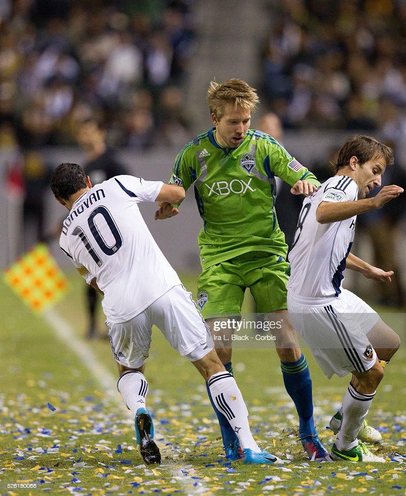 LA Galaxy Captain Landon Donovan and Mike Magee fight for control of the ball against Seattle Sounders player during Western Conference Finals match...