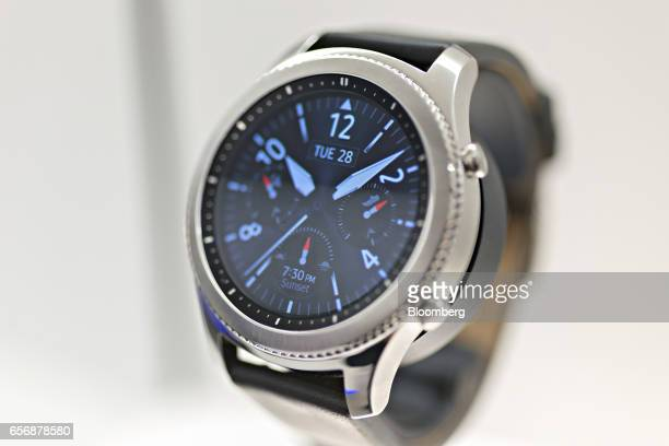 A Galaxy Gear S3 Classic smartwatch produced by Samsung Electronics Co stands on display during the 2017 Baselworld luxury watch and jewelery fair in...