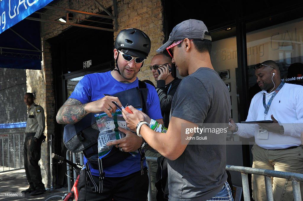 A Galaxy owner tweets #PowerOn to @SamsungMobileUS for delivery of a fully charged battery from a bike messenger at the Samsung Galaxy Experience: TecTile Rewards Program at SXSW 2013 on March 14, 2013 in Austin, Texas.